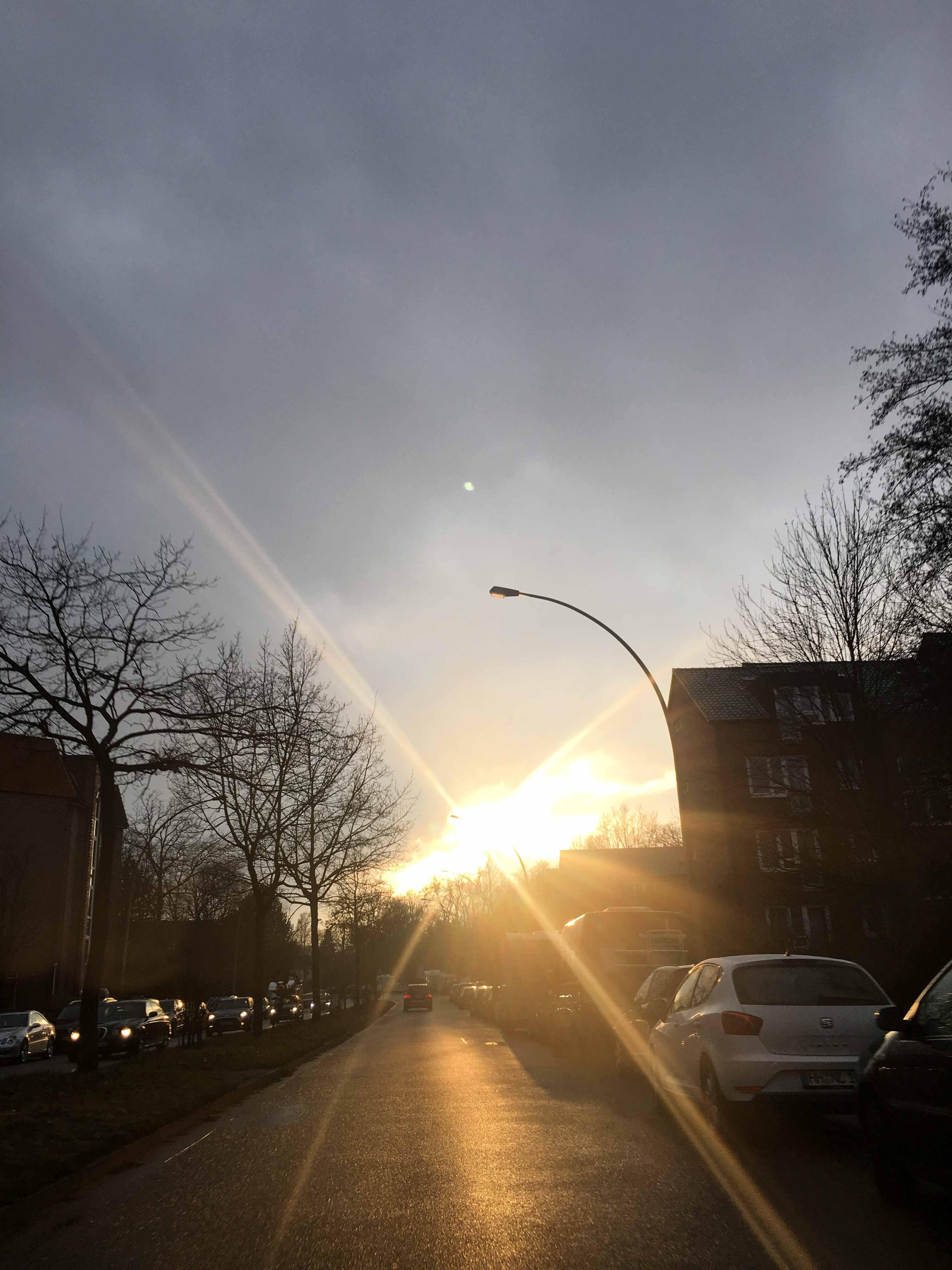 Isfeldstraße Sonne bricht aus Wolken
